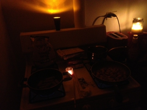 Dinner in the dark. Trying to use up food before it spoils.